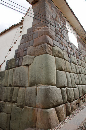 Incredibly precise Inca stone work in Calle Hatunrumiyoc, a pedestrian cobblestone street in Cusco, Peru. The ancient Inca walls still build the foundation for many modern buildings.