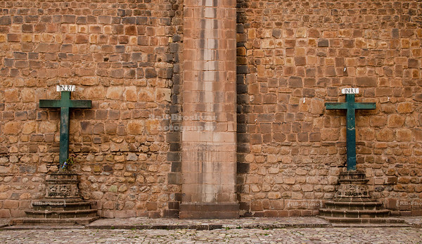 Two green crosses decorate the outer wall of the Cathedral in Cusco, Peru