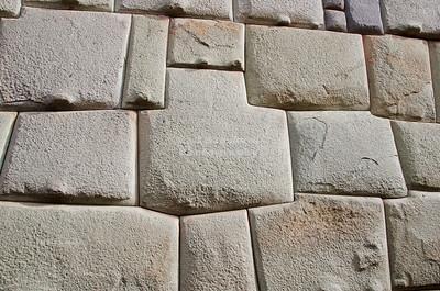 Inca wall in Calle Hatunrumiyoc, a pedestrian cobblestone street in Cusco, Peru
