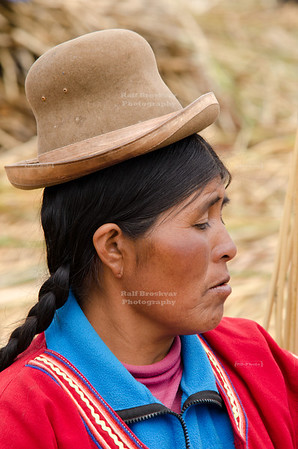Uros woman with traditional headgear, Lake Titicaca, Peru