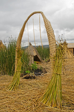 Portal Arch made of reed on the floating islands of the Uros People on Lake Titicaca, Peru, the highest navigable lake in the world