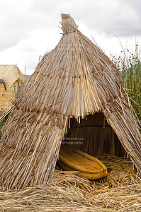 Little reed boat in a reed garage on the floating islands of the Uros people, Lake Titicaca, Peru