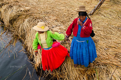 Uros women on a floating island on Lake Titicaca, Peru
