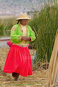 Native woman on the floating reed islands of the Uros People on Lake Titicaca