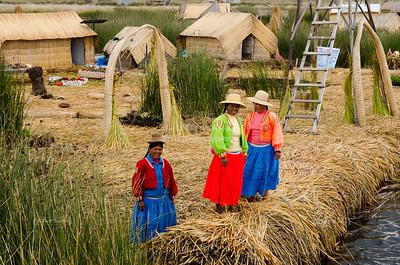 Uros women on a floating island on Lake Titicaca, Peru