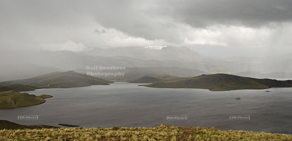 Thunderstorm over a small lake in the Andean Highlands near Puno, Peru
