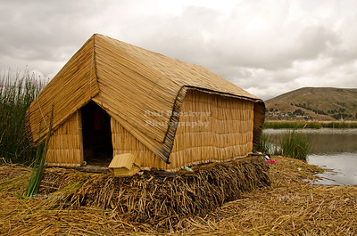 Reed hut on the floating islands of the Uros people, Lake Titicaca, Peru