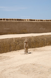 One of the many wooden posts that can be seen on the upper levels of the Huaca Pucllana Pyramid.Miraflores, Lima, Peru