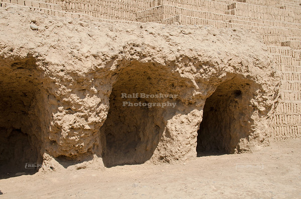 Three excavated tombs at the base of the adobe Pyramid of Huaca Pucllana, Lima, Peru