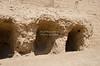 Three excavated tombs at the base of the adobe Pyramid of Huaca Pucllana, Lima, Peru