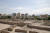 View over the lower parts of the Archaeological Complex Huaca Pucllana with the residential buildings of Miraflores in the background, Miraflores, Lima, Peru