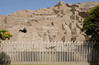 A fence separates the ancient adobe pyramid of Huaca Pucllana, a ceremonial and administrative center for the Lima Culture (200 AD - 700 AD), from the residential streets of Miraflores, Lima, Peru