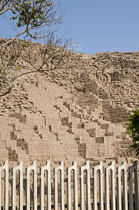 Ancient adobe pyramid of Huaca Pucllana, a ceremonial and administrative center for the Lima Culture (200 AD - 700 AD), from the residential streets of Miraflores, Lima, Peru