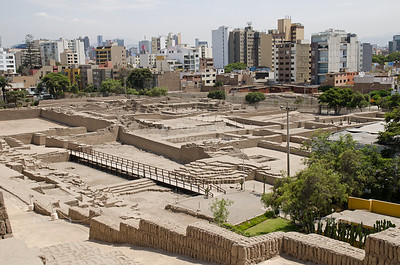 View over the Archaeological Complex Huaca Pucllana with the residential buildings of Miraflores in the background, Miraflores, Lima, Peru