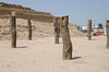 Wooden posts indicate a ritual place on the upper levels of  Huaca Pucllana, Miraflores, Lima, Peru