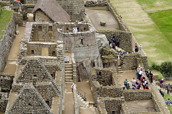 View over Inca ruins with the Temple of the Sun, the only building in Machu Picchu with rounded walls