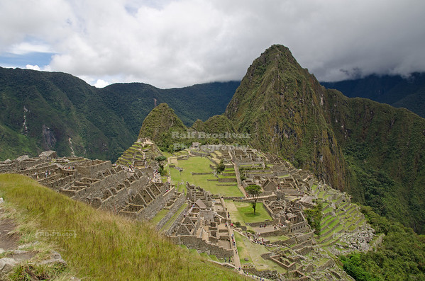 The ruins of the Inca Site Machu Picchu, a UNESCO World Heritage Site and one of the New Seven Wonders of the World. In the background the mountain Huayna Picchu