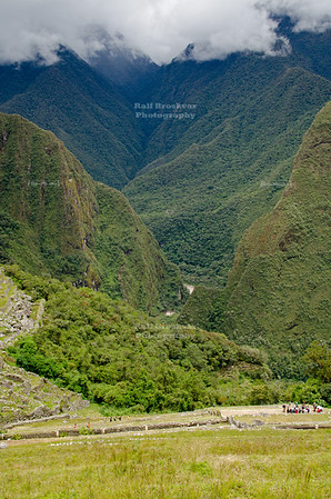 Looking down over the Inca terraces at Machu Picchu into the Urubamba gorge towards the township of Agua Calientes