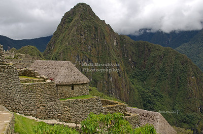 Machu Picchu. Some of the buildings near the entrance were completely restored, including the thatched roofs