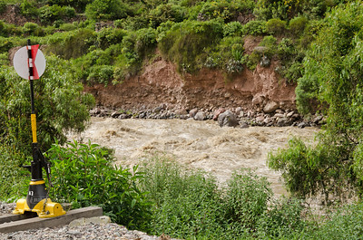 The raging Urubamba River near the Ollantaytambo train station, Peru