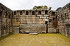 The three-sided Main Temple at Machu Picchu shows some damage in the right back corner caused by the settling ground. Machu Picchu, Peru