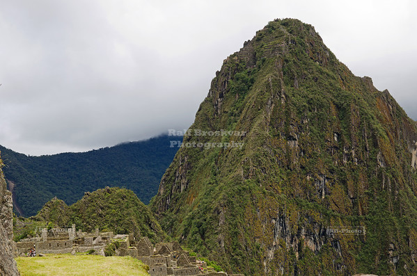The mountain Huayna Picchu, or Wayna Picchu, which means Young Peak in Quechua, towers over the ruins of Machu Picchu, Peru