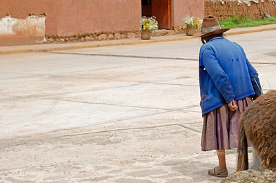 Old woman crossing the street in Chinchero, Peru