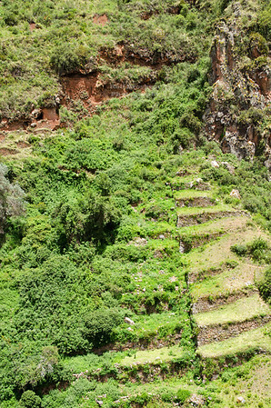 Pre-Inca burial tombs and steep terrace fields at the ancient village of Pisac in Peru