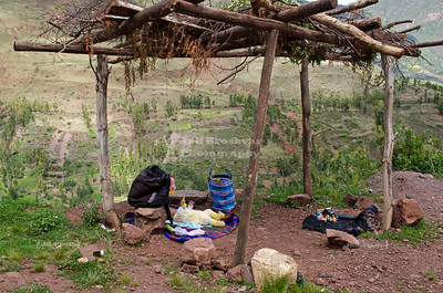 Infant in the shade of a makeshift pergola in the mountains above the Sacred Valley of the Incas, Peru