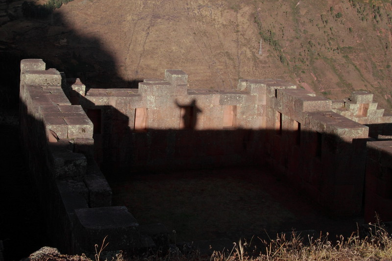Pisac 3865<br /> Inca priest waving at me as I walked by a religious site in the Pisac Ruins, or maybe just my shadow.