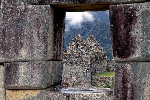 House 4879<br /> Looking through a window at the ruins of another house at Machu Picchu.