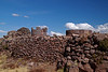 Sillustani 5794<br /> The burial sites on the top of the hill were for the Nobility and upper class. The average and working class were buried at the bottom of the hill and very seldon had towers built for them.