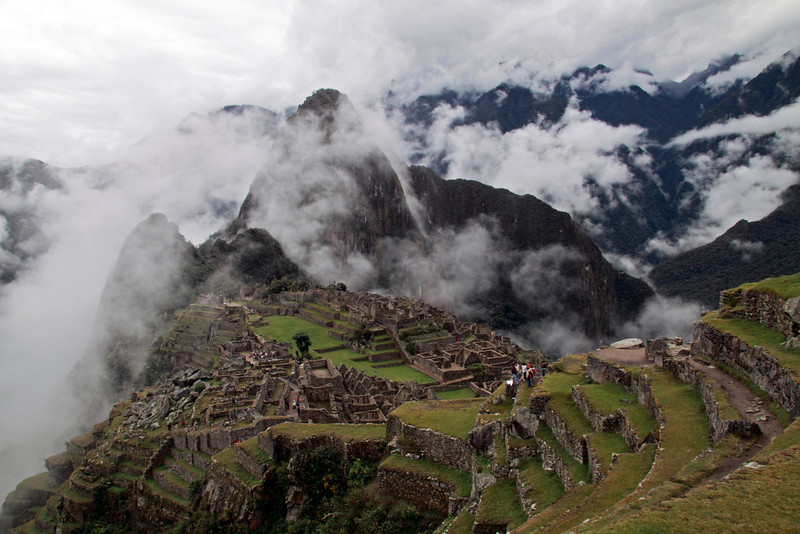 Machu Picchu 4796<br /> Looking at the Farming Terraces above the ruins of Machu Picchu with Huyna Picchu in the clouds.