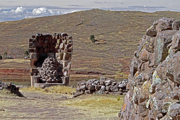 Sillustani 5788<br /> The inside of the towers were built in the shape of a womans uterus. The dead were mummified in fetal positions and then placed in the tombs since the dead would be reborn in the next llife. This is the back side of the Lizard tower.