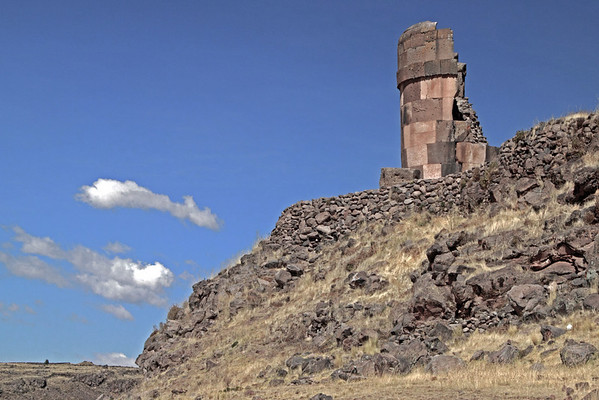 Sillustani 5763<br /> Some of the towers had a lizard carved on one of the stones. The lizard were a symbol of life since they could regrow their tails. The towers opening was always faced east since the sun was reborn each day by mother earth.