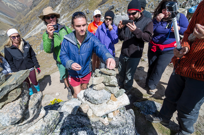 Tribute to Apu Salkantay - leaving chewed three coca leaves under the rock