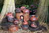 Titticaca 5685<br /> Selection of cooking and storage pots on Uros stove sitting on pieces of Khili.