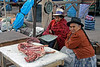Pisac 3954<br /> Vender at open air market in Pisac.
