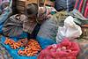 Pisac 3940<br /> Pisac Market, vender selling vegitables