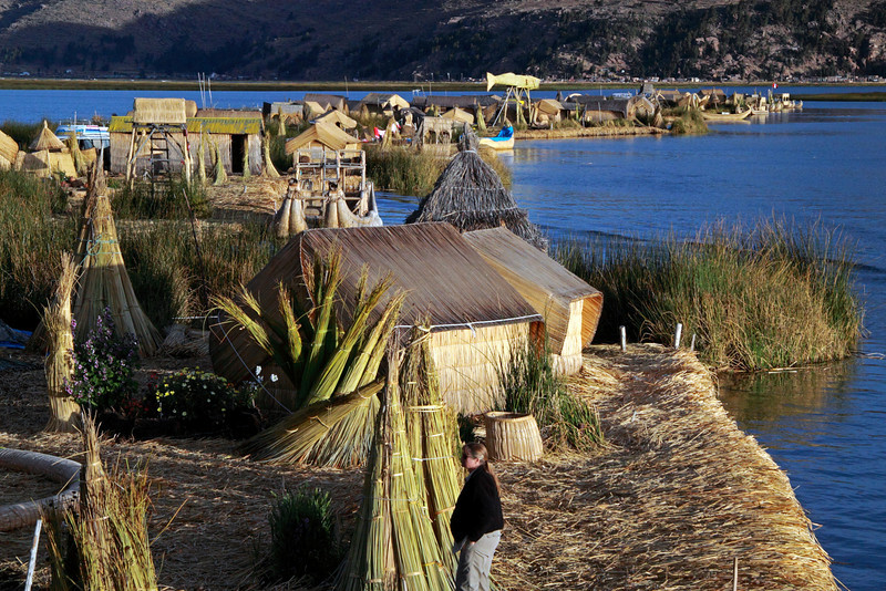 Titicaca 5542<br /> There are 42 man made floating islands on Lake Titicaca. There are approx. 2000 Uros People, with the majority of them living on the mainland. Several hundred Uros still live on and maintain the floating islands. The Uros are a pre Inca people and the islands were built and could be moved to other locations when needed for defensive purposes. The islands and boats are made from the Totora reeds.