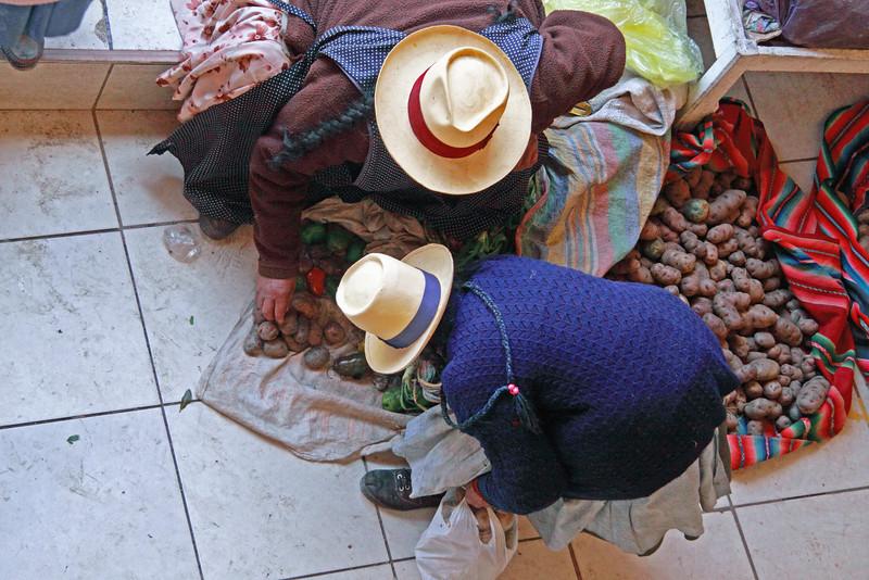 Ollantaytambo 4297<br /> Market in Ollantaytambo. Lady buying potatoes at the market.