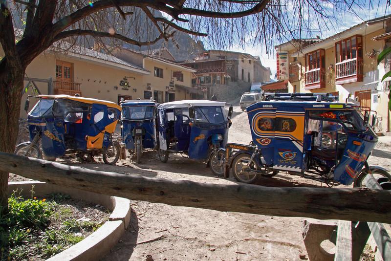 Ollantambo 4217<br /> Three wheel motor bikes used as cabs in Ollantambo parked waiting for passengers.
