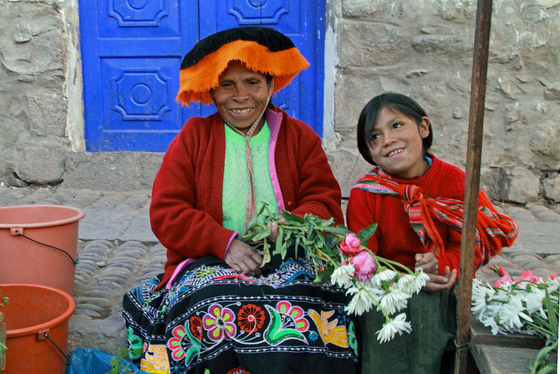 Pisac 3961<br /> Vender at Pisac Market selling flowers