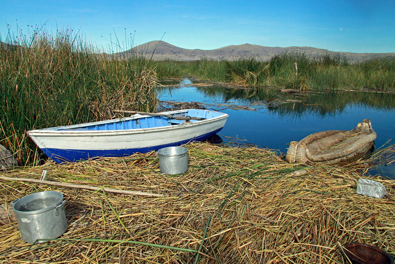 Titticaca 5689<br /> modern boat with Totora boat tied up to floating island.
