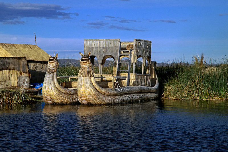 Titicaca 5480<br /> Uros boat tied up to the floating islands on Lake Titicaca are made from the Totora reeds.