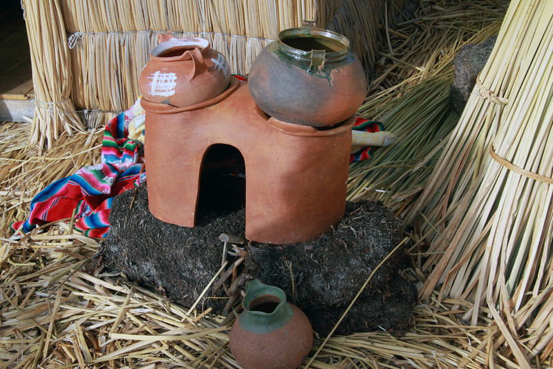 Tittacaca 5607<br /> Uros stove on some Khili. The Khili are the totora roots which form a natural layer that are one to two meters thick. The Khili is the base of the islands with reeds layed on top to form the walking surface.