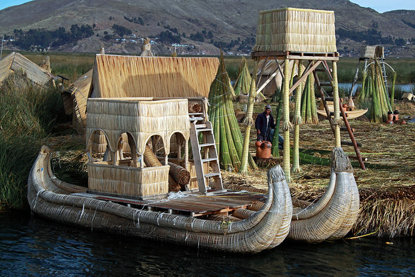 Titticaca 5606<br /> The floating islands need constant upkeep. As the Totora reeds spread over the Khili rot, new reeds will need to be laid down for the walking surface of the island.