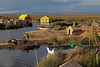 Titicaca 5537<br /> Uros Floating Islands on lake Titicaca. The Khili are the totora roots which form a natural layer that are one to two meters thick. The Khili is the base of the islands with reeds layed on top to form the walking surface. As the reeds rot, new ones are layed on top. The islands are anchored to the bottom of the lake with ropes attached to the sticks stuck in the island.