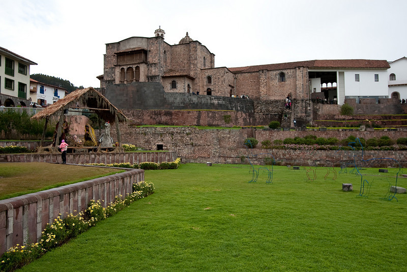 Q'orichancha. The black wall that rises partway up is original Inca wall.