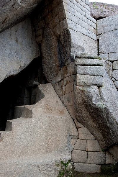 Beneath the Temple of the Sun. Notice now the stone bricks were shaped to match the hourglass contour of the natural rock. Also, notice the steps carved out into the rock.